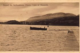 A vintage photographic postcard showing a boat on the Lake of Menteith